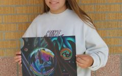 Senior, Mariah Dechant holds her latest piece of art.